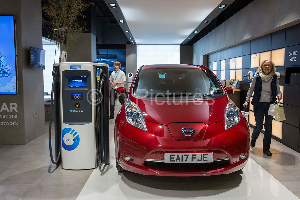Customers looking around the Electric Vehicle Experience Centre inside a shopping centre on Crown Walk, Milton Keynes, United Kingdom. Chargemaster make and install the charging points in the UK through their POLAR Network, which gives access to over 6,000 charging points.