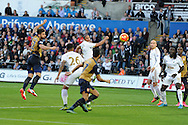 Olivier Giroud of Arsenal (l) scores his teams 1st goal with a header. Barclays Premier league match, Swansea city v Arsenal  at the Liberty Stadium in Swansea, South Wales  on Saturday 31st October 2015.<br /> pic by  Andrew Orchard, Andrew Orchard sports photography.