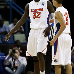 Mar 26, 2011; New Orleans, LA; Florida Gators center Vernon Macklin (32) reacts with teammate guard Scottie Wilbekin (5) after scoring and drawing a foul against the Butler Bulldogs during the first half of the semifinals of the southeast regional of the 2011 NCAA men's basketball tournament at New Orleans Arena.   Mandatory Credit: Derick E. Hingle