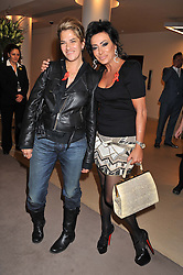 Left to right, TRACEY EMIN and NANCY DELL'OLIO at the Lighthouse Gala Auction in aid of The Terrence Higgins Trust held at Christie's, 8 King Street, St.James' London on 19th March 2012.
