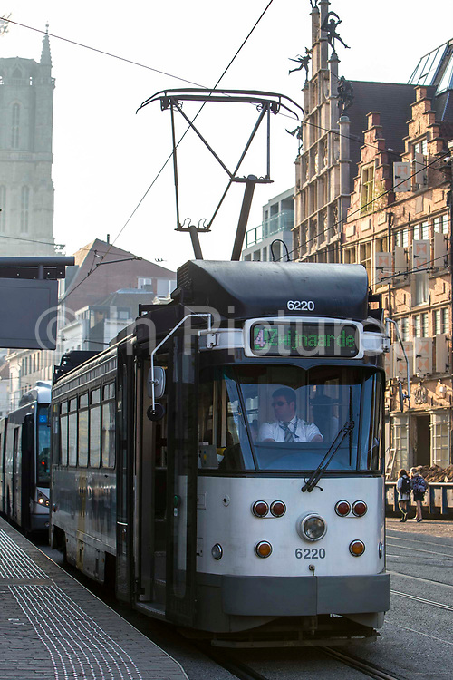 A Belgium tram driver drives his tram through central Ghent city, Belgium.
