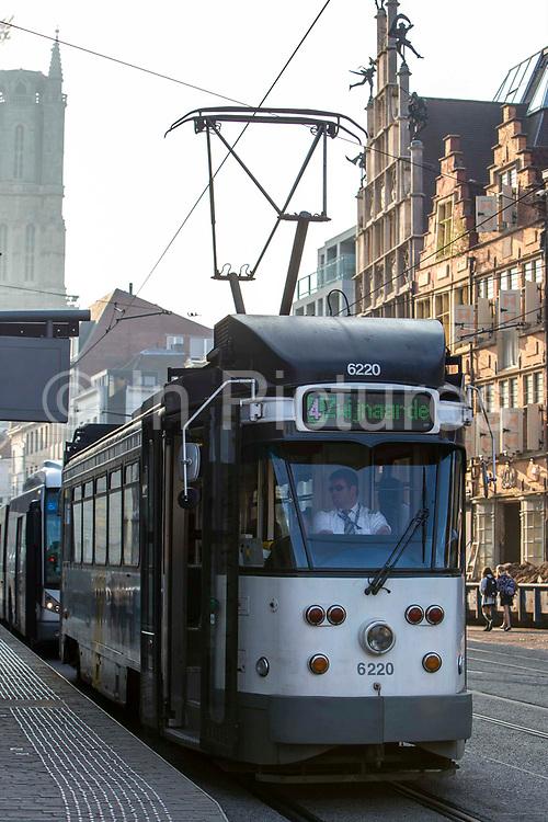 A Belgium tram driver drives his tram through central Ghent city, Belgium.