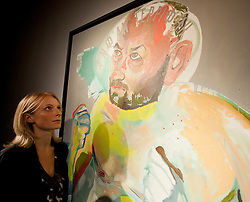 © Licensed to London News Pictures. 05/10/2012. LONDON, UK. A member of Christie's staff looks at a self portrait of the late Martin Kippenberger (untitled, 1992) estimated to fetch GB£2,500,000-3,500,000 at an auction preview in London today (05/10/12). The evening auction, consisting of post-war and contemporary art, takes place at Christie's St James' auction house on the 11 October 2012. Photo credit: Matt Cetti-Roberts/LNP
