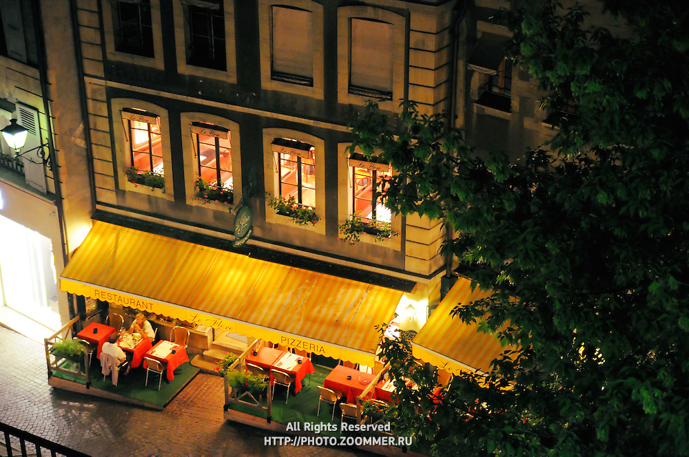 Old town street cafe in Geneva by night.