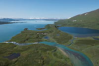Aerial view over flowing rivers and high mountain terrain of Padjelanta national park, Lapland, Sweden