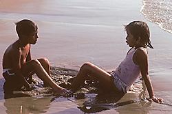 Boy & Girl Playing On Beach