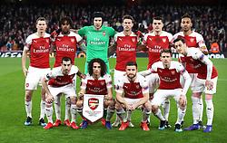 Arsenal players (left to right, top to bottom) Stephan Lichtsteiner, Alex Iwobi, goalkeeper Petr Cech, Laurent Koscielny, Granit Xhaka, Pierre-Emerick Aubameyangduring, Henrikh Mkhitaryan, Matteo Guendouzi, Shkodran Mustafi, Nacho Monreal, and Mesut Ozil prior to kick-off during the UEFA Europa League round of 32 second leg match at the Emirates Stadium, London.
