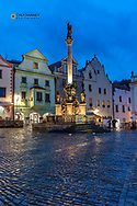 Fountain and Plague Column in Town Square in  Cesky Krumlov, Czech Republic