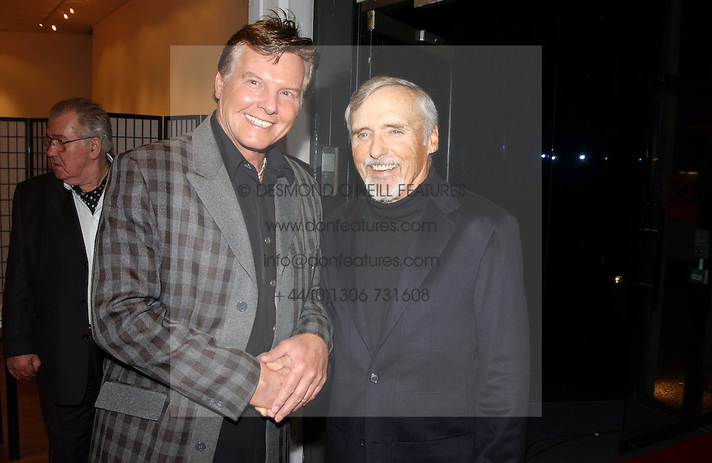 Left to right, actor JESS CONRAD and DENNIS HOPPER at an exhibition of photographs by Jack Cardiff held at The Royal College of Art, Kensington Gore, London on 10th November 2004.<br /><br />NON EXCLUSIVE - WORLD RIGHTS