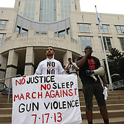 """Event organizers  Shayan Modarres (L) and Olumide Ajile talk on the steps of the Orange County Courthouse during the No Justice No Peace- """"March Against Gun Violence""""  rally on Wednesday, July 17, 2013. The march was organized by the Modarres Law Firm and Orlando attorney Natalie Jackson, one of the attorneys for Trayvon Martins parents. (AP Photo/Alex Menendez)"""