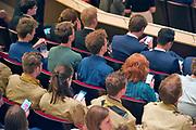 Nederland, Nijmegen, 2-9-2019Tijdens de opening van het academisch jaar zitten veel van de studentenvertegenwoordigers op hun mobiel, smartphone te kijken.Foto: Flip Franssen