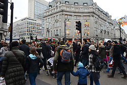 © Licensed to London News Pictures./14/2013. London, UK. Christmas shoppers walk at Oxford Circus during the Christmas shopping season.Photo credit : Peter Kollanyi/LNP