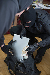 Burglars stealing laptop, fifty Euro banknotes and jewelry
