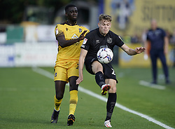 Sutton United's Enzio Boldewijn (left) and Port Vale Lewis Cass battle for the ball during the Sky Bet League Two match at Borough Sports Ground, Sutton. Picture date: Saturday October 9, 2021.