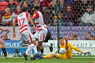 Doncaster Rovers forward Mallik Wilks back heels a shot at goal which is saved by Bradford city goalkeeper Richard O'Donnell during the EFL Sky Bet League 1 match between Doncaster Rovers and Bradford City at the Keepmoat Stadium, Doncaster, England on 22 September 2018.