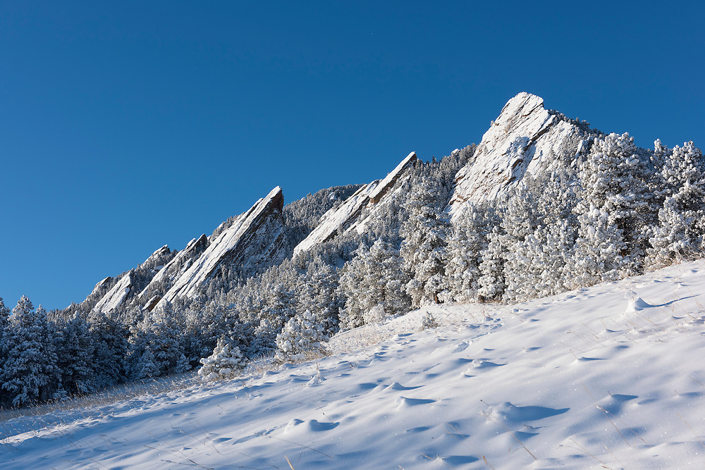 A sunny day at the flatirons in Boulder after a snow storm