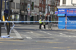 © Licensed to London News Pictures. 28/05/2021. London, UK. A police officer guards a crime scene on Turnpike Lane, north London, following a death of a man. Police were called at just after 1am on Friday, 28 May to reports of a firearm discharge in the vicinity of Turnpike Lane. Police officers, the London Ambulance Service and London's Air Ambulance attended the scene. A man, believed to be aged in his 20s, was found suffering a gunshot injury. Despite the efforts of the emergency services he was pronounced dead at the scene at just before 2am. Photo credit: Dinendra Haria/LNP