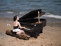 Mermaid and Piano washed ashore under the Brooklyn Bridge.