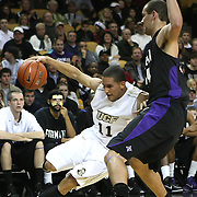 Central Florida guard Isaac Sosa (11) dribbles the ball against Furman forward Chris Toler (44) during an NCAA basketball game at the UCF Holiday Classic at the UCF Arena on December 29, 2010 in Orlando, Florida. (AP Photo/Alex Menendez)