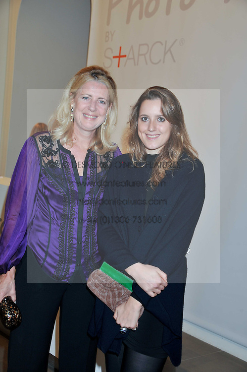 """Left to right, MARIE CLARE AGNEW and her daughter CLARISSA AGNEW at the launch of """"Photo-Me by Starck"""" – a photobooth exclusively designed by the world renowned artist and creator Philippe Starck held at The Saatchi Gallery, Duke Of York Square, Kings Road, London on 2nd November 2011."""