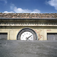 The former capital of Montserrat, Plymouth, which is covered under a layer of ash, mud and rock from the eruption of the Soufriere Hills volcano. Photo shows a clock on a building destroyed by the eruption..