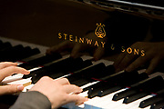 Hands playing a Steinway piano with great dexterity.<br /> Steinway & Sons have been making pianos since 1853 in New York City. A second Steinway factory was established in 1880, in Hamburg, Germany. Both Steinway factories have undergone great updates and renovations, and are still making Steinway & Sons pianos today.