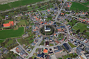 Nederland, Groningen, Gemeente Delfzijl, 01-05-2013; dorp Spijk, wierdedorp (wierde=terp). Beschermd dorpsgezicht met radiale structuur. Hervormde kerk (Andreaskerk) en Molen Ceres.<br /> Village on dwelling Mound, north-east Holland.<br /> luchtfoto (toeslag op standard tarieven);<br /> aerial photo (additional fee required);<br /> copyright foto/photo Siebe Swart