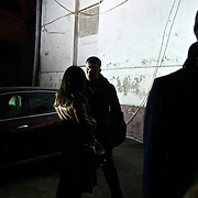 A man talks with a woman at night in Moscow