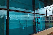 Isn't that taking 'public toilet' a little too literally? Architects design bathroom with transparent glass walls<br /> <br /> Bungling architects in Brazil gave new meaning to the word 'public convenience' - after building bathrooms in a new arts centre with transparent glass walls.<br /> The £800,000 public building in Ponta Grossa, in Brazil's southern state of Parana, was unveiled this week and is covered entirely in glass.<br /> But designers apparently forgot about the loos, which are on the ground floor and give passers-by an unobstructed view of everything happening inside.<br /> With the toilets facing outwards, anyone doing their business would look out onto a busy pedestrian walkway used by university students.<br /> Locals are puzzled by the design and wondering if it's a mistake, or meant to be cutting-edge architecture.<br /> Fitness instructor Rafael Teleska said: 'It's just crazy - I would never use a toilet like this.<br /> <br /> 'Didn't the architect realise that everybody passing by could come and see?'<br /> Student Lorena Max said: 'Did they so it on purpose to get publicity? If not, it's the worst planning blunder ever.'<br /> The building also has two emergency exits on the upper floors that open into thin air.<br /> <br /> Diego Bech told Brazil.dispatch.com:'It's so Big Brother Brazil. So totally wrong. Only in Ponta Grossa do these things happen.'<br /> The planning secretary for Ponta Grossa, Joao Marcal, told Brazil's Globo G1 website that the building 'obviously needs some adjustments' and that the contractor will be responsible for fixing the problem.<br /> ©exclusivepix<br /> The building will house a music school when it opens next month.