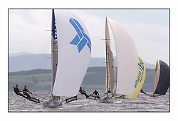 The 2004 Skiff Nationals at Largs held by the SSI.<br /> <br /> Link Associates helmed by Tim Penfold.<br /> <br /> Marc Turner / PFM Pictures