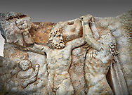 Close up of a Roman Sebasteion relief sculpture of Zeus and Prometheus, Aphrodisias Museum, Aphrodisias, Turkey.  <br /> <br /> Prometheus is screaming in pain. Zeus had given him a terrible punishment for giving fire to man: he was tied to the Caucasus mountains and had his liver picked out daily by an eagle. Herakles shot the eagle and is undoing the first manacle. He wears his trade mark lion-skin and thrown his club to one side. A small mountain nymph, holding a throwing stick appears amongst the rocks. .<br /> <br /> If you prefer to buy from our ALAMY STOCK LIBRARY page at https://www.alamy.com/portfolio/paul-williams-funkystock/greco-roman-sculptures.html . Type -    Aphrodisias     - into LOWER SEARCH WITHIN GALLERY box - Refine search by adding a subject, place, background colour, museum etc.<br /> <br /> Visit our ROMAN WORLD PHOTO COLLECTIONS for more photos to download or buy as wall art prints https://funkystock.photoshelter.com/gallery-collection/The-Romans-Art-Artefacts-Antiquities-Historic-Sites-Pictures-Images/C0000r2uLJJo9_s0