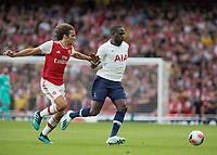 Football - 2019 / 2020 Premier League - Arsenal vs. Tottenham Hotspur<br /> <br /> Matteo Guendouzi (Arsenal FC) and Moussa Sissoko (Tottenham FC)  race for the loose ball at The Emirates.<br /> <br /> COLORSPORT/DANIEL BEARHAM