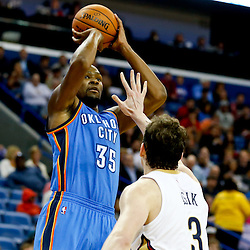 Dec 2, 2014; New Orleans, LA, USA; Oklahoma City Thunder forward Kevin Durant (35) shoots over New Orleans Pelicans center Omer Asik (3) during the second half of a game at the Smoothie King Center. The Pelicans defeated the Thunder 112-104. Mandatory Credit: Derick E. Hingle-USA TODAY Sports