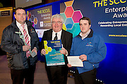 27/01/2014 SCCUL Enterprise Award<br /> Consumer Goods & Services<br /> (Businesses under 3 Years)<br /> Winner<br /> Denis Sheehy and Shane Kelly from Rainsavers t/a Cloudbrook Water were presented with their prize by Ivan McPhilips GMIT(centre)<br /> This is one business you will want to know about….<br /> Over the next couple of years the Government is getting ready to extract more money from us in the form of charges for services which were previously free.<br /> God help any body with teenagers when the government introduces the water charges. There will be mutinies in houses across the land as beleaguered parents  try to monitor their offspring's time in the shower and water usage.<br /> You will be queuing up looking for the number of this winner.<br /> This company has invented a worldwide patented rainwater harvesting system.<br /> Their advanced rainwater harvesting systems collects filters and stores rainwater before distributing for consumption & for non-potable water activities including toilet flushing, washing and gardening and all without the need for costly and expensive ground works. All their systems provide certified drinking water standard. This is Rainwater recovery the way it should be: automatic and effortless<br /> The winner is Rainsavers t/a Cloudbrook Water – and the owner is Denis Sheehy.<br /> Their prize is<br /> •specially commissioned piece of sculpture from locally based sculptor Liam Butler<br /> •€1000 cash<br /> •Full page Business profile worth €1250 in the Galway Independent SCCUL Enterprise Awards Souvenir Supplement which will be published  <br />  Photo:Andrew Downes.
