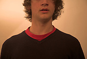 Cut off head portrait Caucasian young man showing upper body shoulders lower face