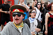 Peaceful protesters making their point in various ways during the general strike march in central London. At this stage of the day this protest moved away from the main group and went up Whitehall where police contained the crowd.
