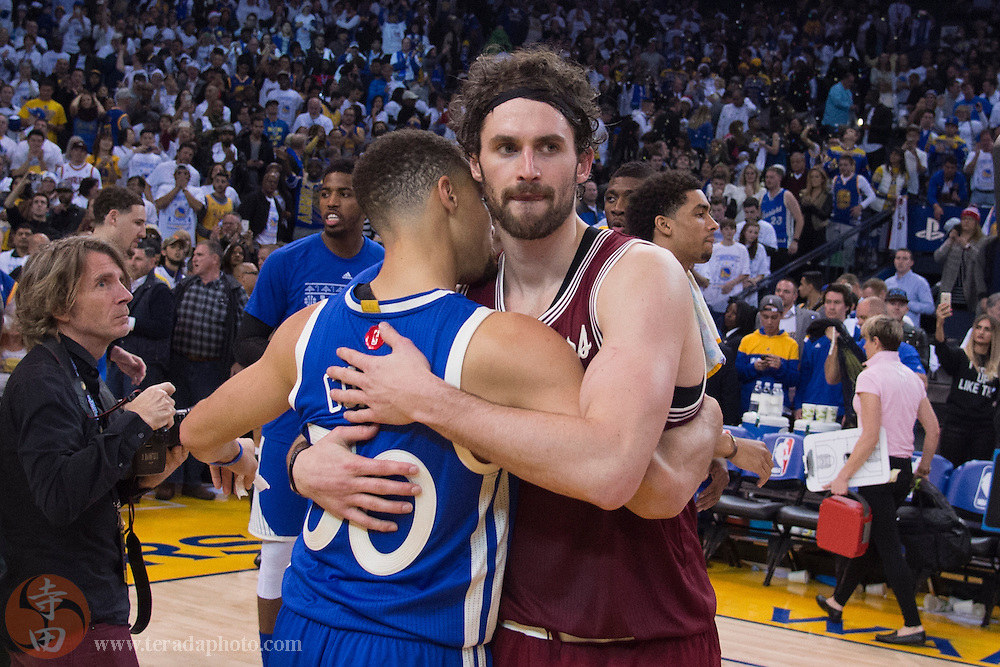 December 25, 2015; Oakland, CA, USA; Cleveland Cavaliers forward Kevin Love (0, right) hugs Golden State Warriors guard Stephen Curry (30, left) after a NBA basketball game on Christmas at Oracle Arena. The Warriors defeated the Cavaliers 89-83.