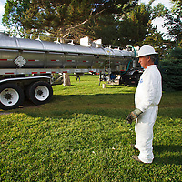 Chevron cleanup worker pumping oil from pond in Liberty Park, Salt Lake City