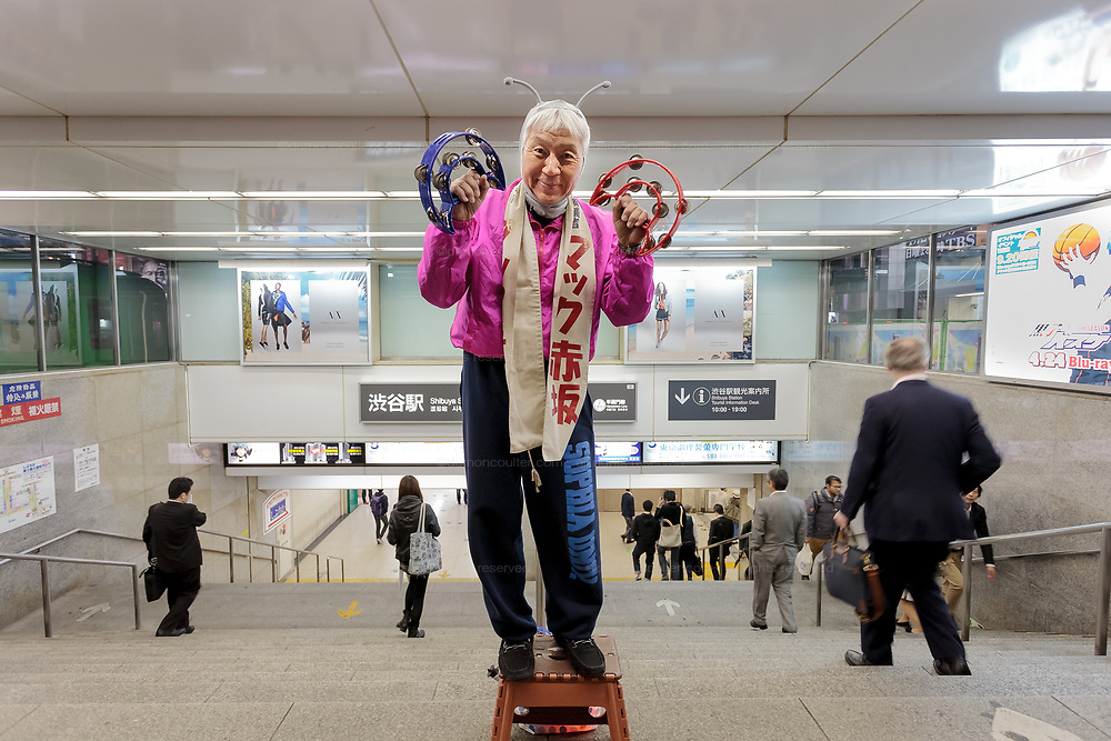 Makoto Tonami, known as, Mac Akasaka, of the Japan Smile Party campaigning in his own unique style in Shibuya, Tokyo, Japan. Friday April 17th 2015