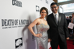 Dinesh D'Souza and Debbie D'Souza at Death Of A Nation Los Angeles Premiere held at Regal L.A. Live: A Barco Innovation Center on July 31, 2018 in Los Angeles, California, United States (Photo by Jc Olivera for Jade Umbrella)