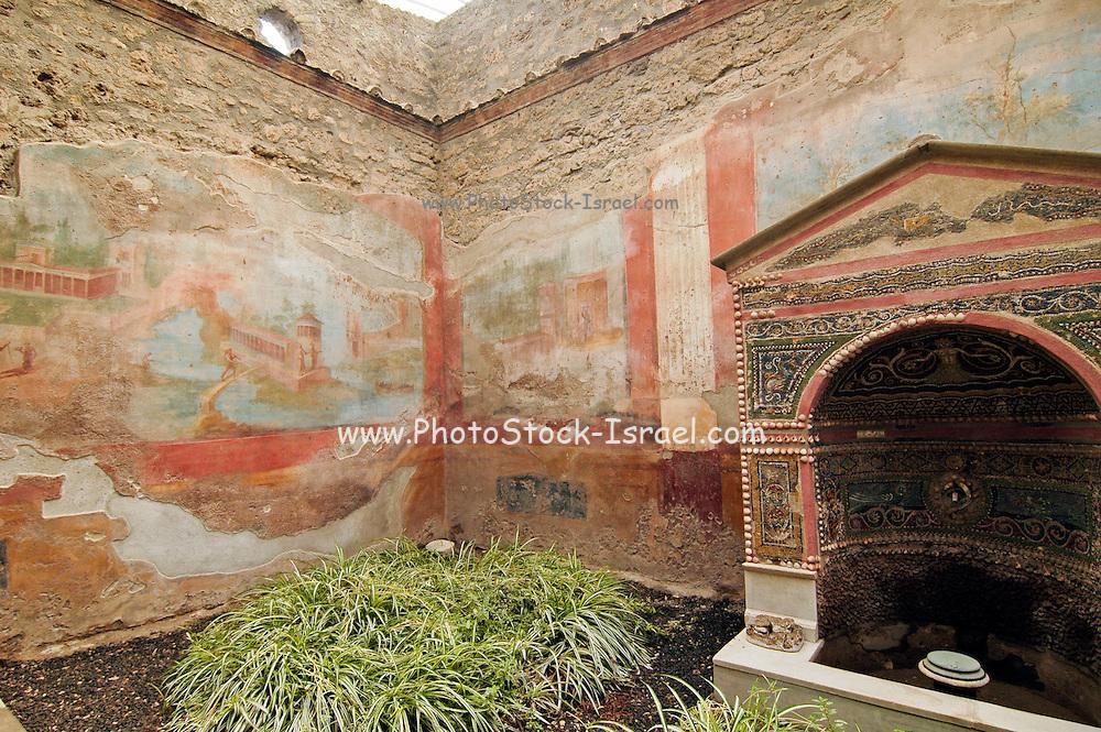 The well frescos and fountain at the House of the small fountain, Casa Della fontana piccola, the ruins at Pompeii, Campania, Italy under the Vesuvius volcano,