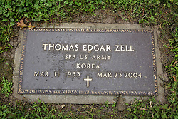 26 August 2017:   A part of the History of McLean County Illinois.<br /> <br /> Tombstones in Evergreen Memorial Cemetery.  Civic leaders, soldiers, and other prominent people are featured.<br /> <br /> Section 16 - Veterans Section<br /> Thomas Edgar Zell<br /> SP3 US Army<br /> March 11, 1933<br /> March 23, 2004