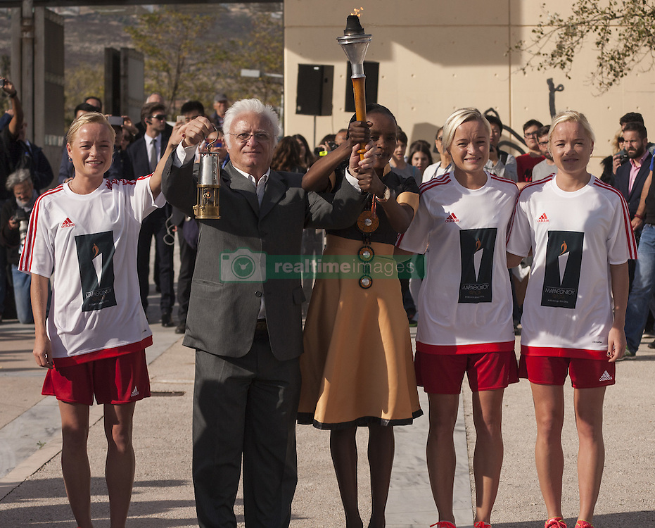 November 12, 2016 - Marathonas, Greece - Luik sisters hold the marathon torch together with Jemima Sumgong (C). Ceremony in the Greek city of Marathonas as part of the 35 Athens Marathon th Authentic. (Credit Image: © George Panagakis/Pacific Press via ZUMA Wire)