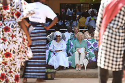 First Lady of the Gambia Fatou Bah-Barrow (left) with the Duchess of Cornwall watching a performance during a visit to St Teresa's School in Banjul, The Gambia, on day two of the royal couple's trip to west Africa.
