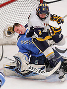 Wausau West's Kellen Tharalodson, right, crashes into Superior goalie Peyton Flanders during the second period at a WIAA state tournament championship game. (Photo © Andy Manis)