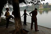 Morning Tai Chi exercises around Hoan Kiem Lake, Hanoi