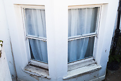 Peeling paint and rotten window frames are just part of Retired James Gosling's concerns involved in a long running dispute with Camden council that began when his flat was flooded with sewage. West Hampstead, London, October 25 2018.