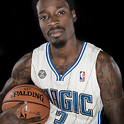 Manny Harris poses in front of a backdrop during the Orlando Magic media day event at the Amway Arena on Monday, September 30, 2103 in Orlando, Florida. (AP Photo/Alex Menendez)