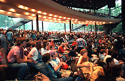 Audience before The Grateful Dead Concert at the Saratoga Performing Arts Center, 24 June 1984. Visible in this shot, taken from venue floor right side, is the sound and lights boards, the balcony and ramps leading to the lawn. Candace Brightman and Dan Healy are visible in the booth.