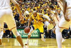 Jan 20, 2018; Morgantown, WV, USA; West Virginia Mountaineers guard Jevon Carter (2) drives to the basket during the second half against the Texas Longhorns at WVU Coliseum. Mandatory Credit: Ben Queen-USA TODAY Sports